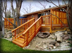 Archadeck Colorado redwood deck over rock wall