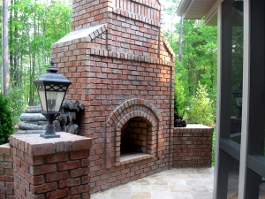 Outdoor fireplace on travertine
