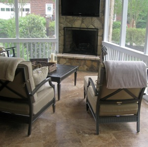 Screened porch with outdoor fireplace and built in large screen TV