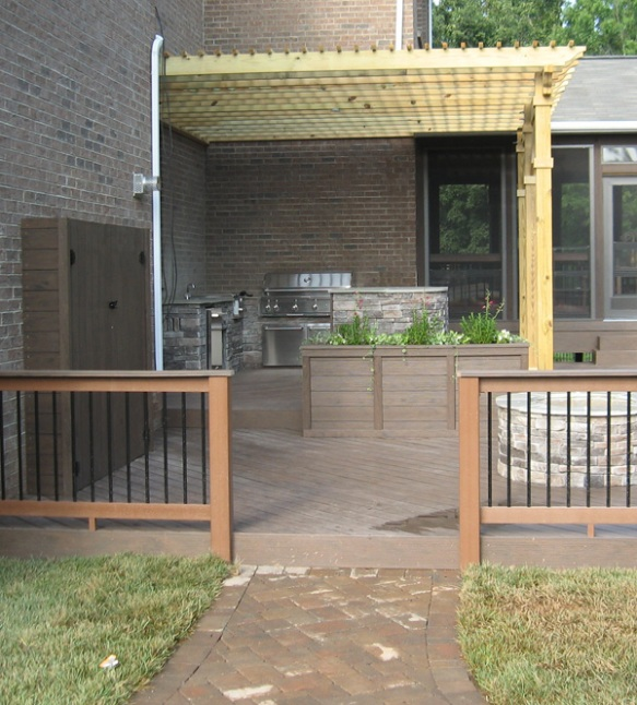 Stone walk, deck with rail, pergola and outdoor kitchen