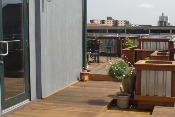 Metal and wood planters on roof deck
