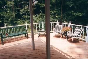Pressure-treated wood deck by Archadeck