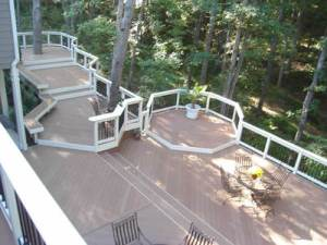 Deck with bench seating around tree