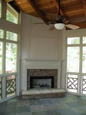 Outdoor fireplace in screened porch