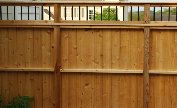 Cedar privacy fence with aluminum balusters
