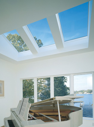 Here is an example of a sunroom that makes beautiful music with Velux skylights.