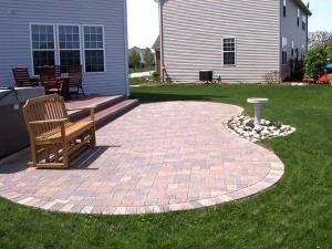 The curved lines of this patio open it up to the backyard and provide a more casual feeling