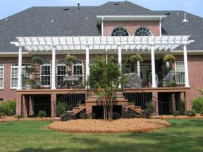 Composite deck which uses the pergola to create a covered porch effect
