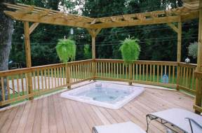 These double pergolas promote intimacy and space definiton around this hot tub deck