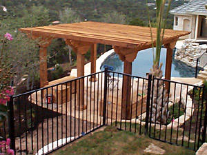 This poolside pergola uses heavy timber to provide ample protection from the elements