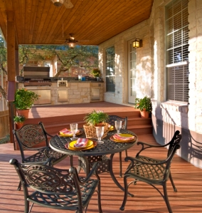 This porch features a fully eqipped outdoor kitchen and dining area