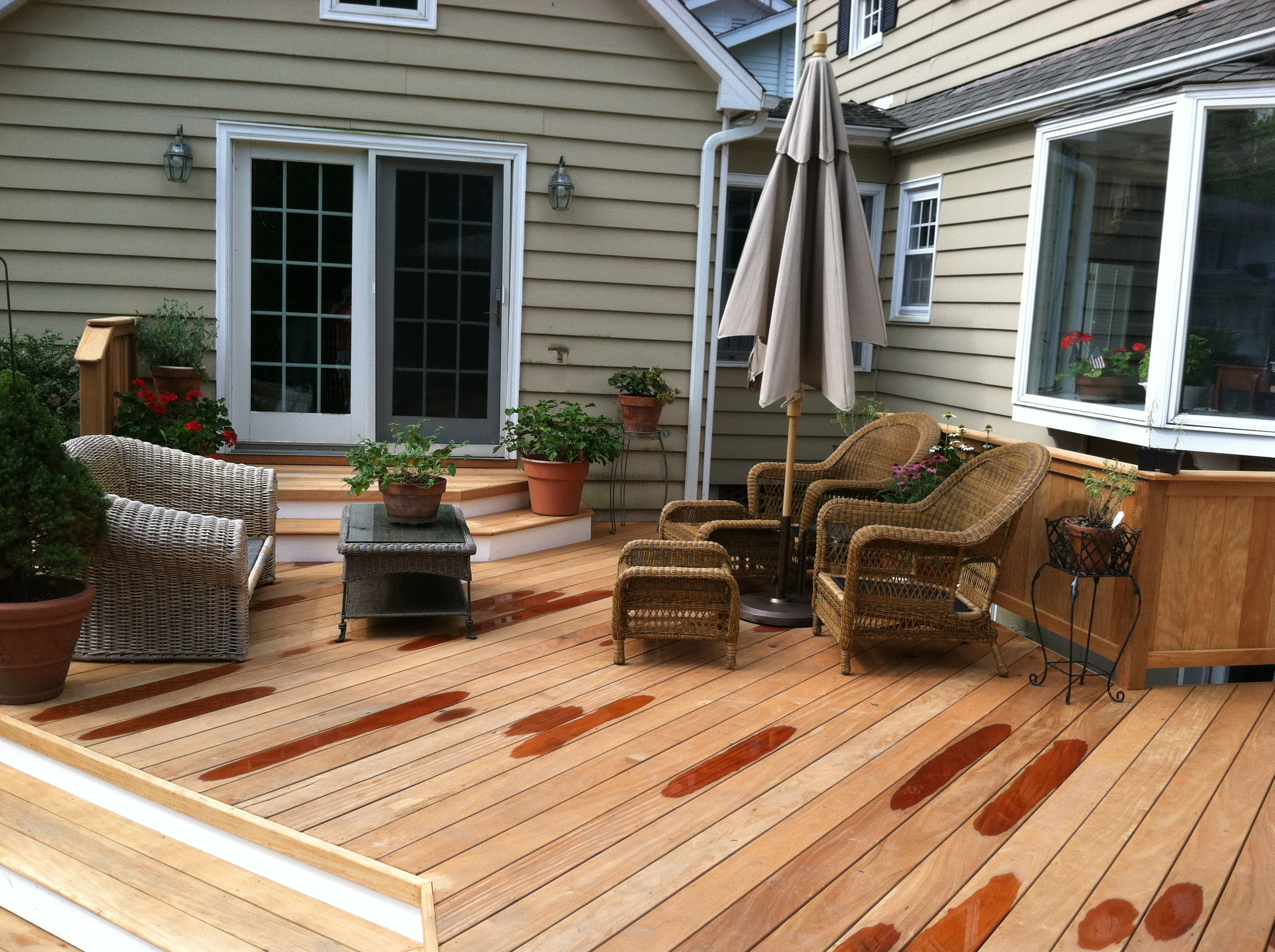 Wood decks archadeck custom decks patios sunrooms and for Backyard sunroom