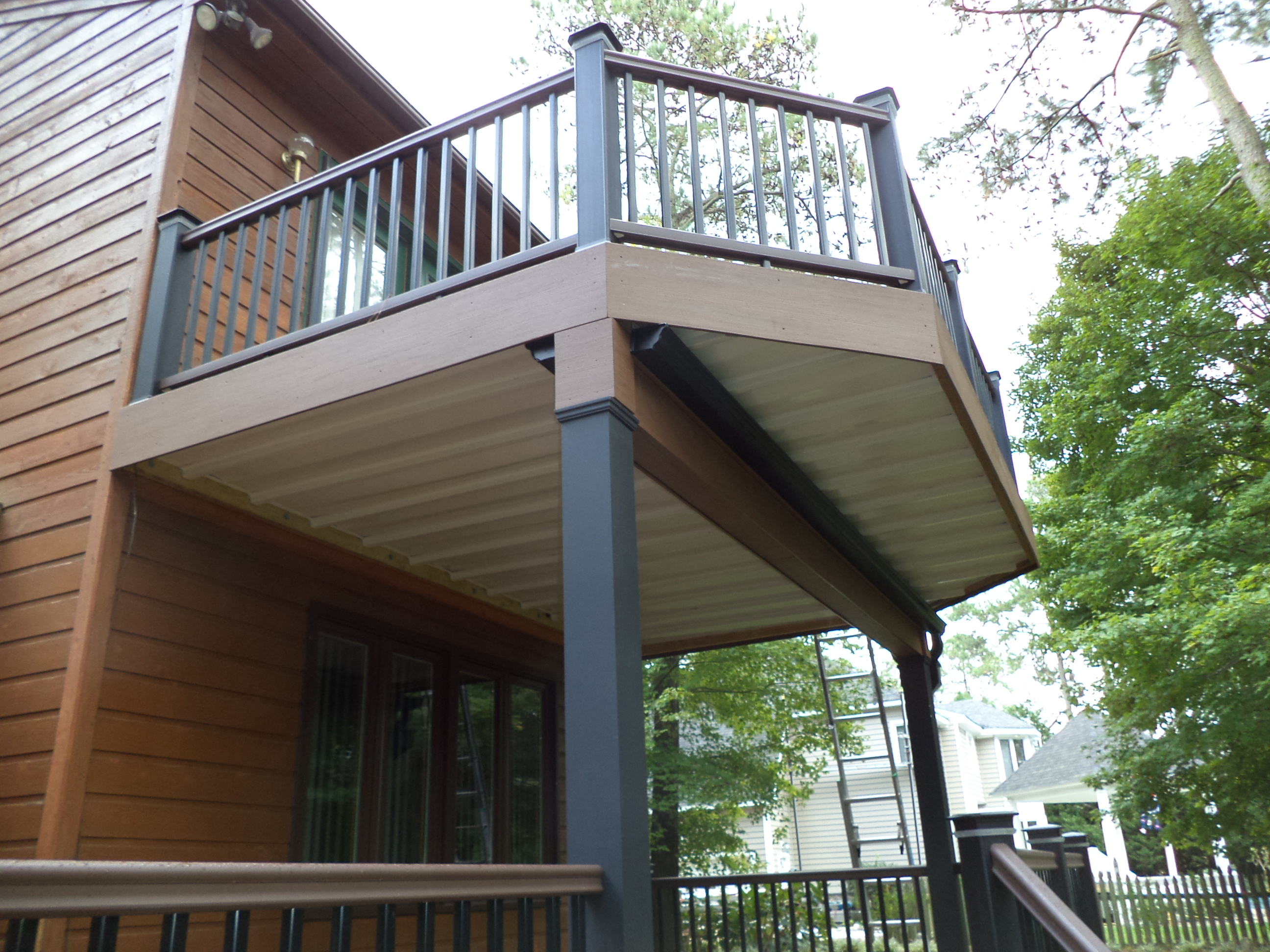 under decking archadeck custom decks patios sunrooms and