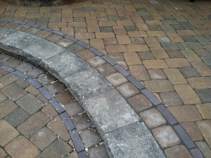 Switching up the pattern of the stone clearly defines the different areas of the patio