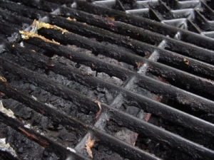 A good grill brush will clean away this built up grime and crust