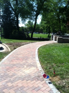 The brick-like finish flanked by Dublin Cobble is the perfect segue to the newly completed patio