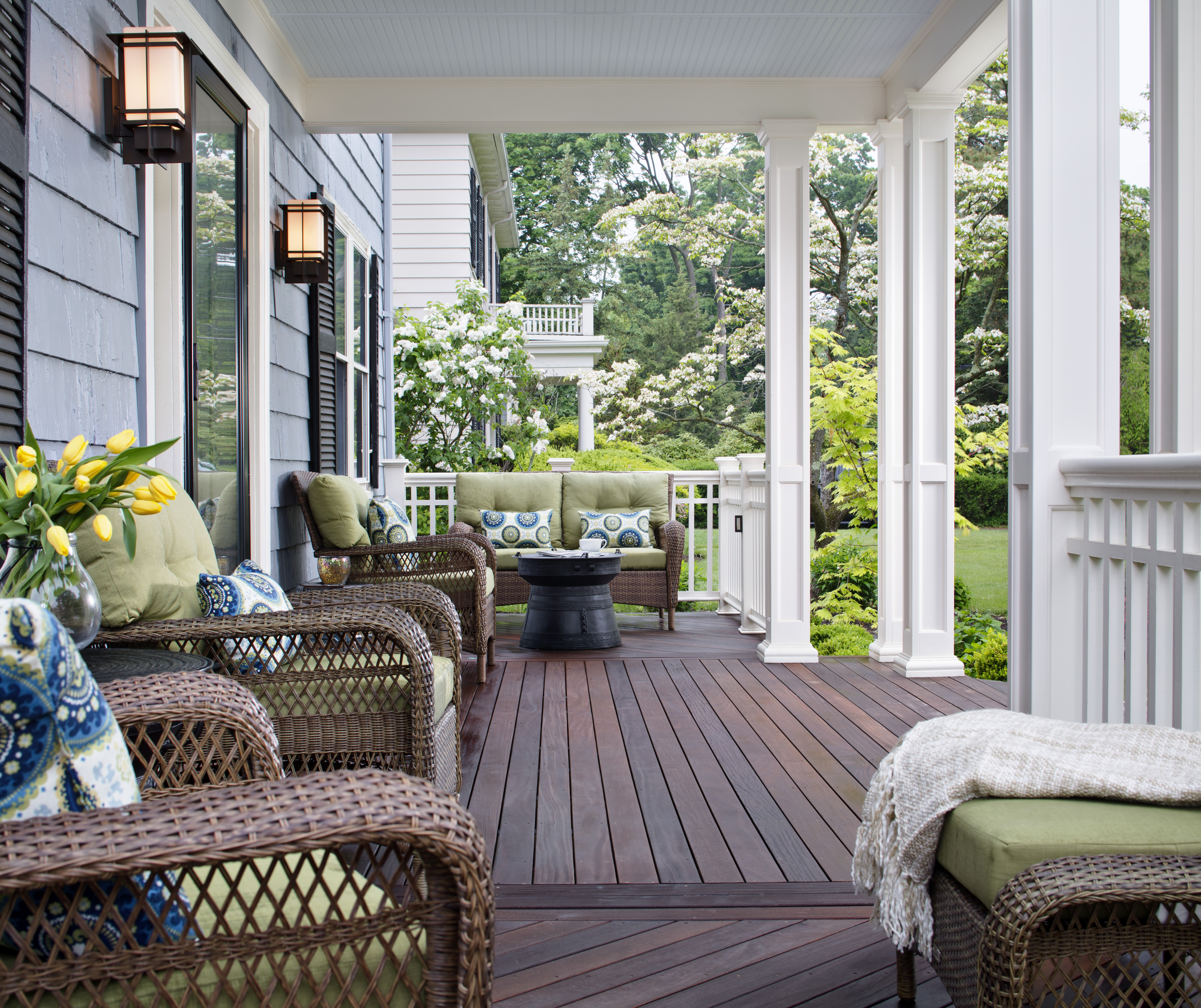 While many front porches have stone floors, wood decking was used ...