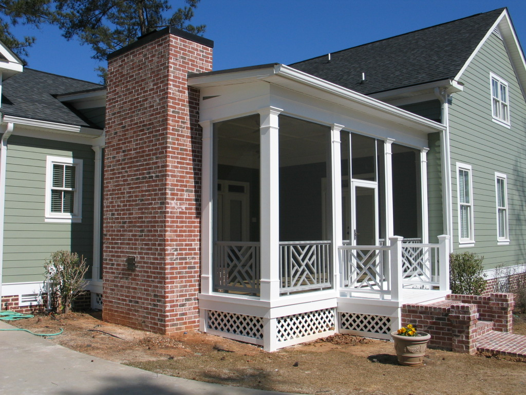 Sunrooms archadeck custom decks patios sunrooms and for Houses with screened in porches