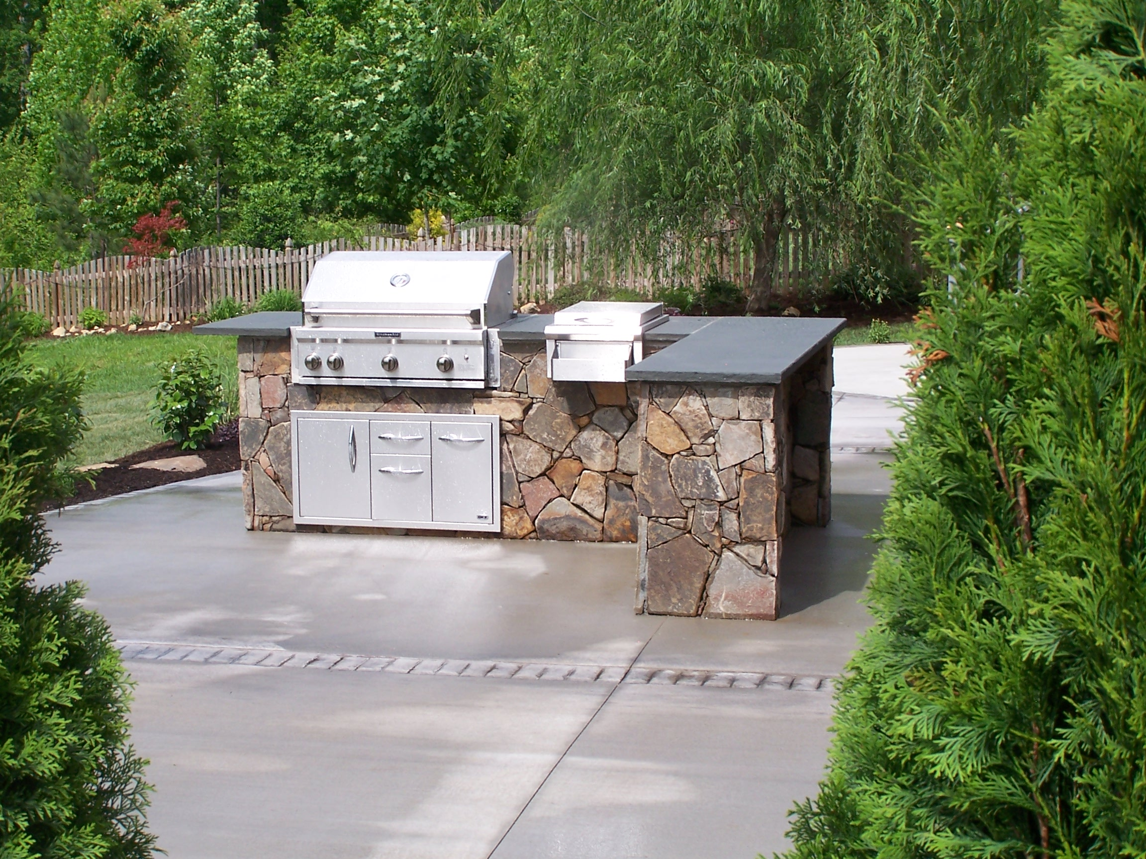 Outdoor kitchens archadeck custom decks patios for Outdoor stone kitchen designs